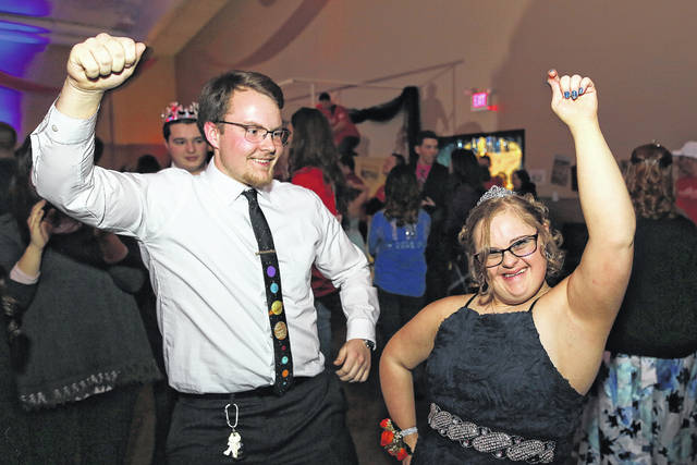 William Deisler, of Paulding, and Kori Hawk, of Harrod, share a dance during the Night to Shine prom sponsored by the Tim Tebow Foundation held at the First Assembly of God on Friday evening.