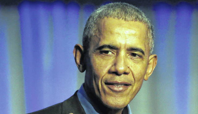 FILE- In this Dec. 5, 2017, file photo, former President Barack Obama address the participants at a summit on climate change involving mayors from around the globe in Chicago. A Democratic group backed by former President Barack Obama plans to invest millions of dollars in state-level elections in a dozen states this year, with its heaviest focus on Ohio.
