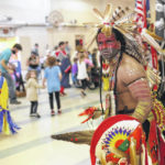 Join in a Native American powwow
