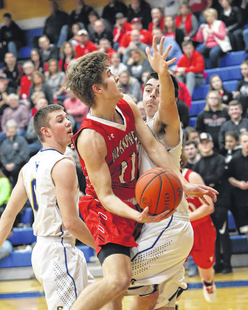 Wapakoneta's Aaron Good looks to find space to put up a shot against St. Marys' Colin Clements during Friday night's game at St. Marys. Todd B. Acker | The Lima News