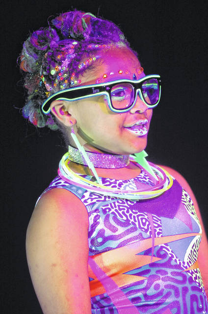 Je'lionna Reynolds poses on the runway Thursday night during Ohio State Beauty Academy's student talent showcase Glamour & Glow-Neon Night at the UNOH Event Center in Lima. The look was designed by Ashley Reynolds. See LimaOhio.com for more photos.