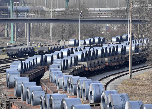 Steel coils sit on wagons when leaving the thyssenkrupp steel factory in Duisburg, Germany, Friday, March 2, 2018. U.S. President Donald Trump risks sparking a trade war with his closest allies if he goes ahead with plans to impose steep tariffs on steel and aluminum imports, German officials and industry groups warned Friday. (AP Photo/Martin Meissner)