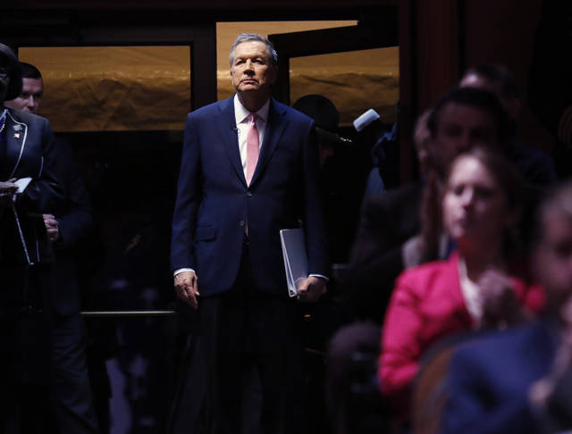 Ohio Gov. John Kasich waits to be introduced for the Ohio State of the State address in the Fritsche Theater at Otterbein University in Westerville, Ohio, Tuesday, March 6, 2018. (AP Photo/Paul Vernon)