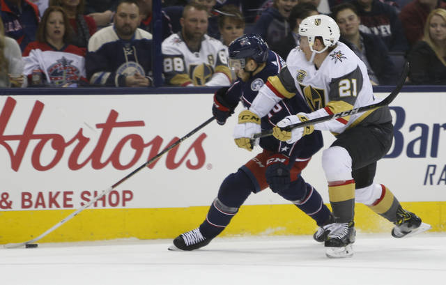 Columbus Blue Jackets' Alexander Wennberg, left, of Sweden, and Las Vegas Golden Knights' Cody Eakin chase the puck during the second period of an NHL hockey game Tuesday, March 6, 2018, in Columbus, Ohio. (AP Photo/Jay LaPrete)