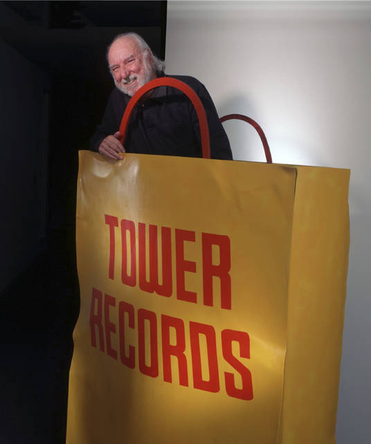 FILE - In this 1997 file photo, Russell Solomon, founder of Tower Records, is photographed inside a sculpture at the Tower Records headquarters in Sacramento, Calif. Solomon, who founded the Tower Records chain that became a global phenomenon and changed the way people consumed music, has died in his Sacramento home. He was 92. The Sacramento Bee reports Solomon was watching the Oscars on Sunday, March 4, 2018, with his wife when he died. (Michael A. Jones/The Sacramento Bee via AP, File)