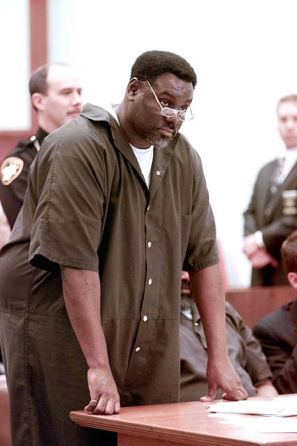 In this April 6, 2000 file photo, Nathaniel Cook stands during his sentencing at Lucas County Courthouse in Toledo, Ohio. Nathaniel Cook, one of two brothers who admitted killing a 12-year-old girl during a string of murders in the early 1980s could get out of prison within months.  Cook admitted he took part in three of those slayings with his brother, Anthony Cook, who's now serving two life sentences.  A judge has set a hearing for Thursday, March 8, 2018, to begin determining whether Cook should be registered as a sex offender if he's released.   (Lori King/The Blade via AP)