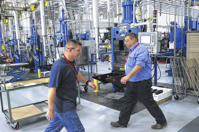 Workers pass along industrial machines in October at Lord Corporation, a manufacturer of industrial coatings, adhesives, bearings, and sensing equipment for range of commercial markets, including United States military contracts in Erie, Pa. After reviewing Labor Department data going back to 2008, the AP found that a third of major U.S. metro areas communities are shedding a greater percentage of white-collar than blue-collar jobs.