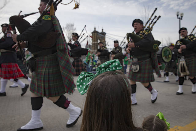 FILE - In this March 12, 2016, file photo, revelers watch the Cincinnati St. Patrick Parade beside Smale Park at The Banks in downtown Cincinnati. From big-buck incentives to less-tangible coolness, Cincinnati made a wide-ranging pitch to woo Amazon's second headquarters in a failed bid. (AP Photo/John Minchillo, File)