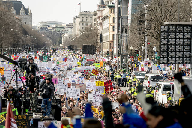 "In this March 24, 2018, photo, people hold the ""March for Our Lives"" rally in Washington in support of gun control. They have walked out, marched and demanded action across America to stop gun violence. But it's far from certain that the young people behind the ""March for Our Lives"" movement will be a political force at the ballot box this fall. (AP Photo/Andrew Harnik)"