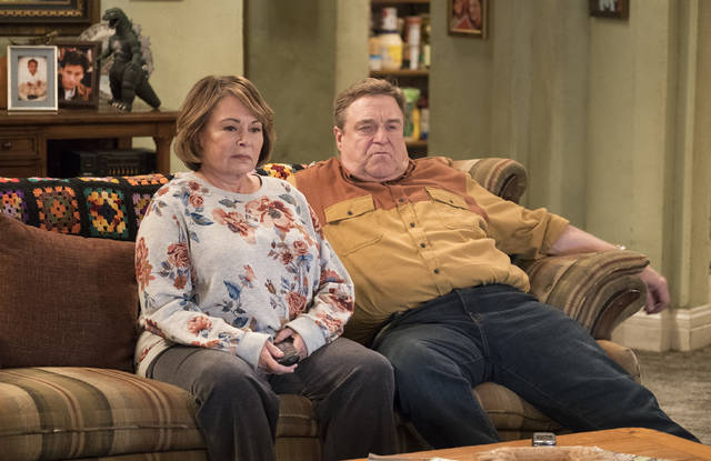"Roseanne Barr, left, and John Goodman appear in a scene from the reboot of ""Roseanne."" In Tuesday night's reboot, Roseanne was at odds with her sister Jackie, played by Laurie Metcalf, over President Donald Trump. Barr said she thought it was important to show how the Conner family deals with the same issues many American families are facing. (Adam Rose/ABC via AP, File)"