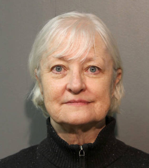 HOLD FOR STORY BY DON BABWIN - FILE - This January 2018, file photo provided by the Chicago Police Department shows Marilyn Hartman. Hartman, who authorities say is a serial stowaway and recently sneaked onto a plane in Chicago, to London, has the local judicial system struggling as to what to do with her. Hartman is due back in court this week and the central question for the judge is what to do about a woman who's repeatedly tried to board commercial flights without a ticket. (Chicago Police Department via AP)