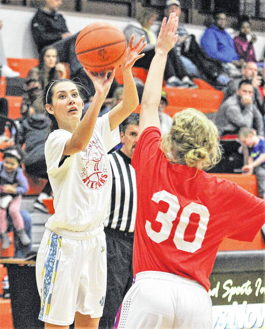 Jaidyn Hale of Bath (left) shoots a 3-pointer over Paige Motycha of Crestview in the 2018 District 8 All-Star game that featured some of the top talent in Division I -IV held at the Elida Fieldhouse on Monday evening.