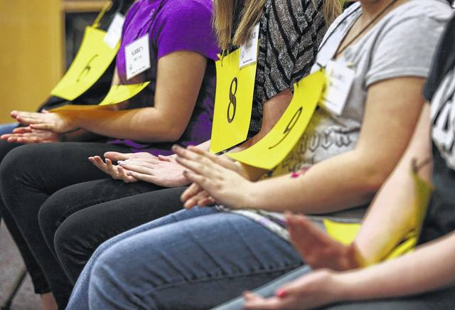 Past spelling bee participants compete.