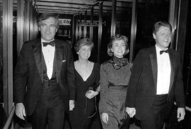 """FILE - In this Oct. 12, 1988 file photo, Vince Foster, left, walks with his wife and then Gov. Bill Clinton and his wife Hillary Rodham Clinton, in Little Rock, Ark. No new autopsy was performed on former White House deputy counsel Vince Foster at a U.S. Navy hospital in Virginia, despite the claim of an online story that experts there found evidence of a homicide. The story from usapoliticstoday claimed Foster's body was exhumed and examined at """"the Naval Hospital in Norfolk, Virginia."""" The article also alleged there was no autopsy when Foster died in 1993."""