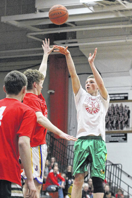 Cory-Rawson's Eric Ritter puts up a shot against eleases a three-point attempt over Delphos St. John's Richard Cocuzza of Delphos St. John's  during Tuesday night's District 8 Division IV All-Star Game at the Elida Fieldhouse.