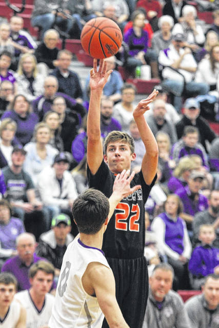 Coldwater's Jacob Wenning puts up a shot against Fort Recovery's Grant Knapke during a Thursday night Division III district semifinal at Lima Senior.