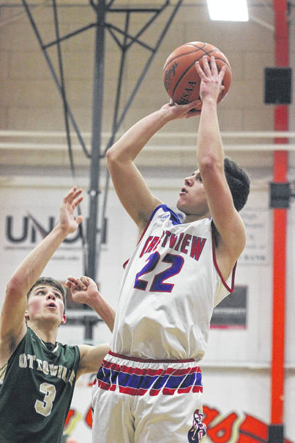 Crestview's Jace Vining puts up a shot against Ottoville's Ryan Bendele during a Tuesday night Division IV district semifinal at the Elida Fieldhouse.    Levi A. Morman | The Lima News