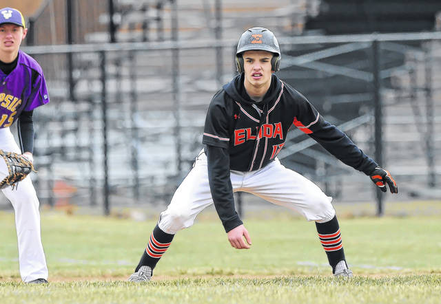 Elida's Drew Brockert leads off first base during Saturday's game against Leipsic at Ed Sandy Field. See more game photos at LimaScores.com.