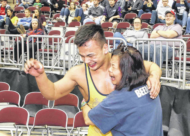 Ottawa-Glandorf's Daniel Beemer gets a hug from his mother, Marissa, after winning the 182-pound state Division III championship Saturday at The Ohio State University's Jerome Schottenstein Center in Columbus.