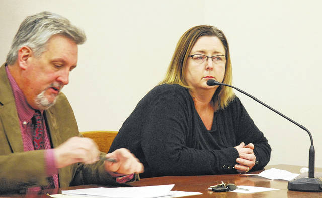 Heather O'Connor sits with her attorney, Robert Grzybowski, during a sentencing hearing Thursday in Allen County Common Pleas Court. O'Connor was sentenced to five years on probation for stealing funds from the Shawnee Middle School Parent Teacher Committee and the Little Indians volleyball booster club.