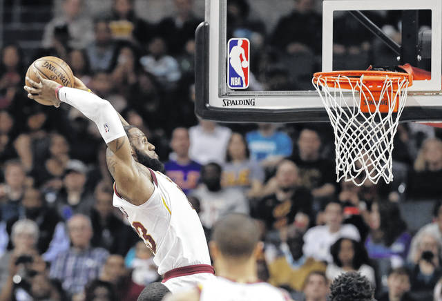 Cleveland Cavaliers' LeBron James goes up to dunk against the Charlotte Hornets during the first half of an NBA basketball game in Charlotte, N.C., Wednesday, March 28, 2018. (AP Photo/Chuck Burton)