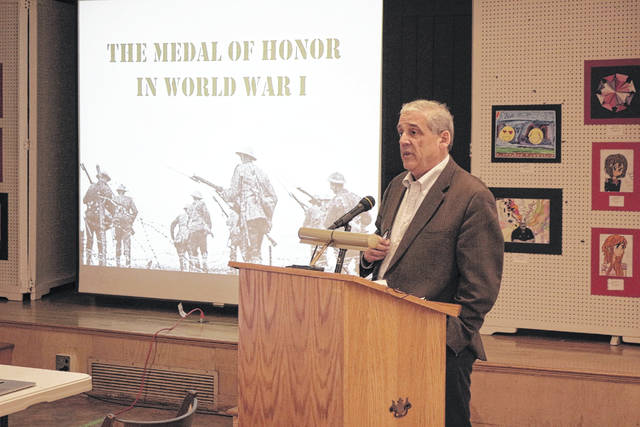 Lima attorney Larry Huffman discusses the Medal of Honor at a program Sunday at the Allen County Museum.