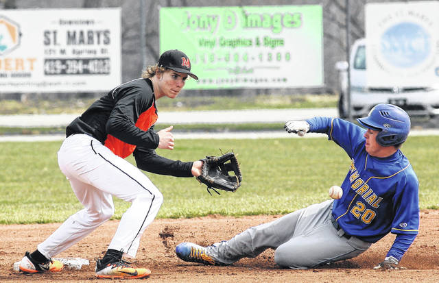 St. Marys' Clay Quellhorst steals second before Minster's Alex Lehmkuhl can apply the tag during Saturday's doubleheader in St. Marys.