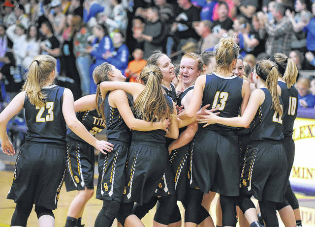 Ottawa-Glandorf players celebrate their victory against Western Reserve in Saturday's Division III regional final at Lexington High School.