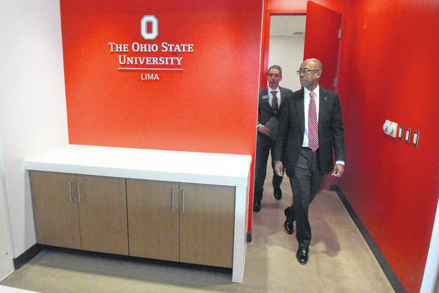 OSU President Michael Drake tours the new Perry Webb Student Life Building during a tour on Friday afternoon with OSU/Lima Associate Dean, F'abio Leite.