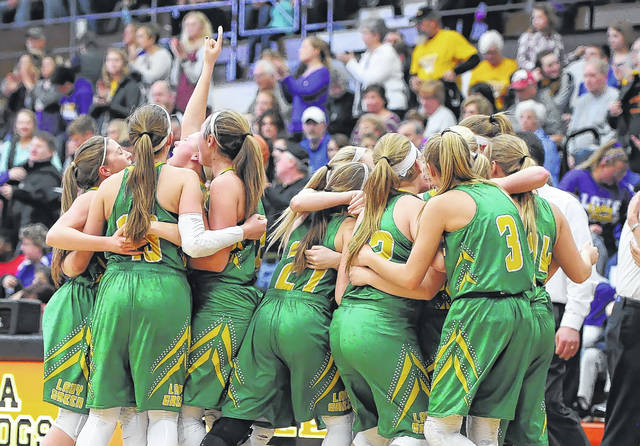 Ottoville celebrates after earning another trip to the Division IV state tournament in Columbus at 1 p.m. Thursday.