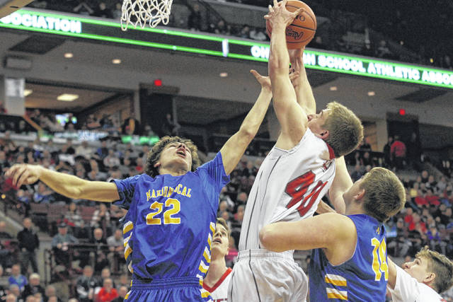 Pandora-Gilboa's Eli Phillips fights for a rebound against Marion Local's Matt Rethman, left, and Jack Buening during a Thursday Division IV state semifinal in the Value City Arena at the Schottenstein Center in Columbus. See more game photos at LimaScores.com.