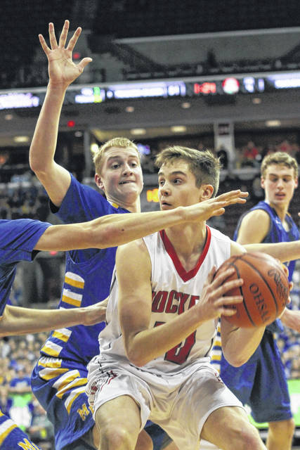 Marion Local's Nathan Bruns helps guard Pandora-Gilboa's Drew Johnson during a Thursday Division IV state semifinal in the Value City Arena at the Schottenstein Center in Columbus.
