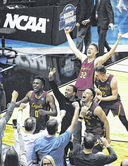 Loyola-Chicago center Carson Shanks (32) and other players celebrate after a regional final NCAA college basketball tournament game against Kansas State on Saturday. Loyola won 78-62.