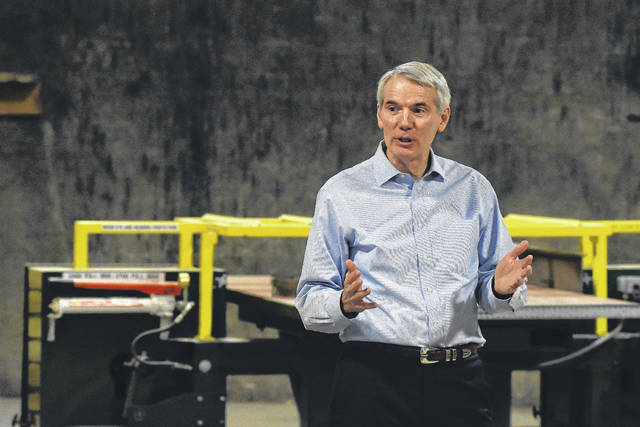U.S. Senator Rob Portman, addresses a audience after a tour of Lima Pallet Company on Monday.