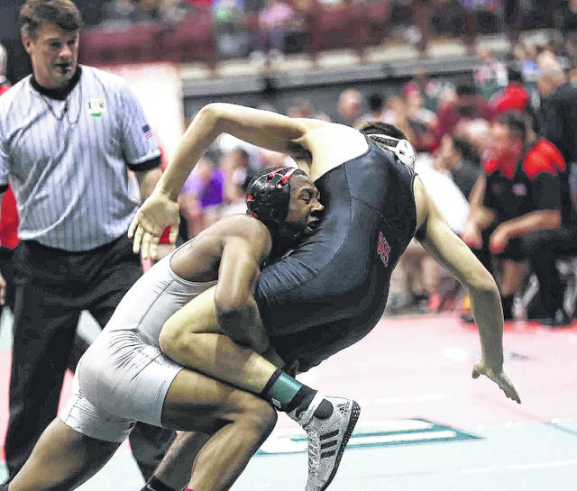 Lima Senior's Naeem Russell lifts up Brecksville-Broadview Heights' Ben Vanadia during a Division I match at the state tournament Thursday at The Ohio State University.
