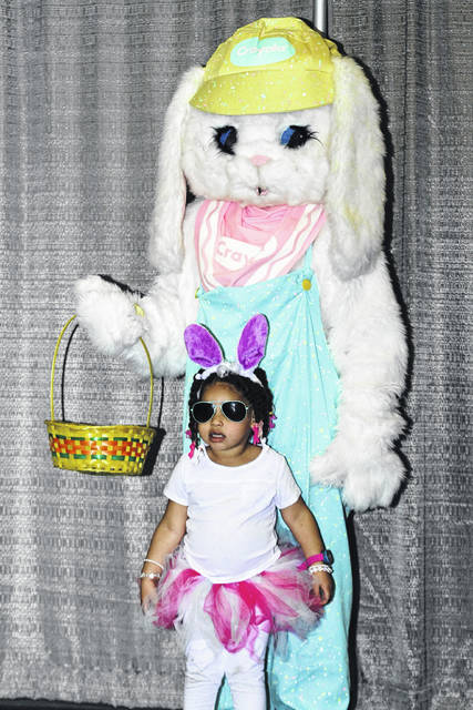 Amiyah Bowens poses with the Easter bunny at last year's event.