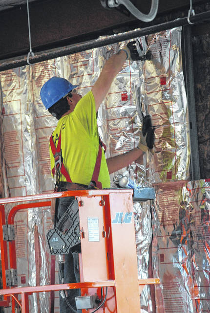 Skilled union laborers from dozens of trades are currently working in a downtown Lima office complex being constructed for Dominion Energy.