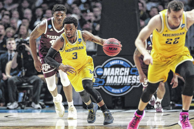 Xavier Simpson (3), of Lima. has played a key role in getting Michigan into the Final Four.