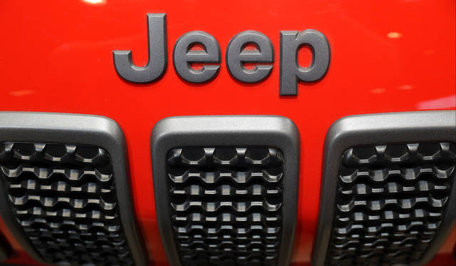 FILE- In this Feb. 8, 2018, filephoto, the Jeep Cherokee sits on display at the Chicago Auto Show in Chicago. U.S. auto sales grew 6.3 percent in March on rising sales of SUVs and pickup trucks. (AP Photo/Charles Rex Arbogast, File)