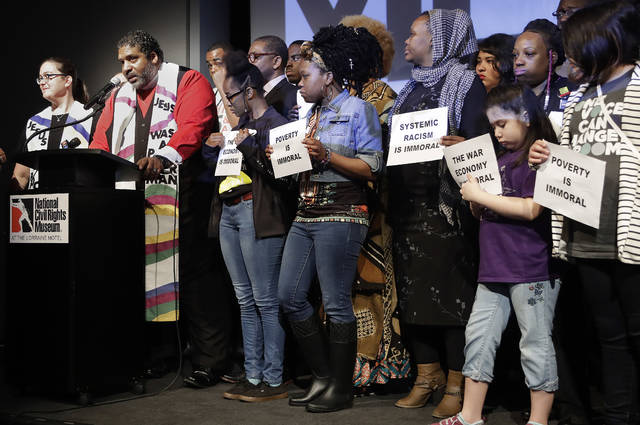 "The Rev. Dr. William J. Barber II, second from left, and the Rev. Dr. Liz Theoharis, left, co-chairs of the Poor People's Campaign, speak at the National Civil Rights Museum on Tuesday, April 3, 2018, in Memphis, Tenn. They announced the campaign is preparing for 40 days of non-violent ""direct action"" in about 30 states that will climax with a rally in Washington this June. The organization is the rekindling of the campaign to help poor people that the Rev. Martin Luther King Jr. was working on when he was killed April 4, 1968, in Memphis. (AP Photo/Mark Humphrey)"