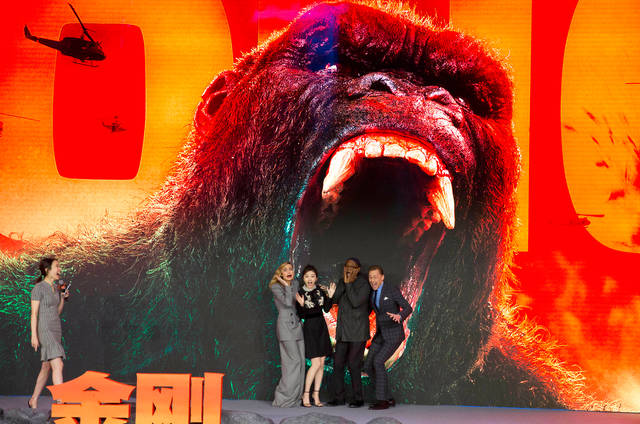 "In this March 2017 file photo, the cast of movie ""Kong: Skull Island,"" from left, Brie Larson, Jing Tian, Samuel L. Jackson and Tom Hiddleston, pose for a photo during a press conference in Beijing, China. Propelled by growth in China, global moviegoing reached a record high of $40.6 billion in 2017 despite a downturn in audiences at U.S. and Canada theaters. Much of the global increase was thanks to China, which accounted for $7.9 billion in ticket sales."