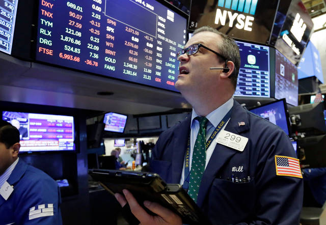 Trader William Lawrence works on the floor of the New York Stock Exchange, Wednesday, April 4, 2018. Stocks are opening sharply lower on Wall Street as an escalating trade dispute between the U.S. and China poses a threat to global economic growth and corporate profits. (AP Photo/Richard Drew)