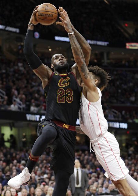 Cleveland Cavaliers' LeBron James, left, drives to the basket against Washington Wizards' Kelly Oubre Jr. in the first half of an NBA basketball game, Thursday, April 5, 2018, in Cleveland. (AP Photo/Tony Dejak)