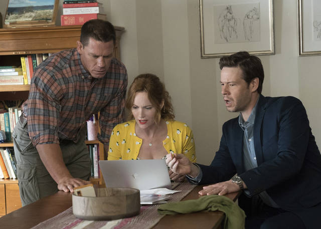 "This image released by Universal Pictures shows John Cena, from left, Leslie Mann and Ike Barinholtz in a scene from ""Blockers."" (Quantrell D. Colbert/Universal Pictures via AP)"