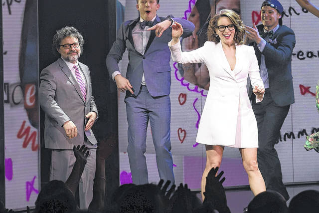 """Jeff Richmond, left, and Tina Fey participate in the curtain call for the """"Mean Girls"""" opening night on Broadway at the August Wilson Theatre on Sunday in New York."""