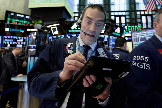 Trader Gregory Rowe works on the floor of the New York Stock Exchange, Monday, April 9, 2018. Stocks are opening solidly higher on Wall Street, led by gains in big technology companies. (AP Photo/Richard Drew)