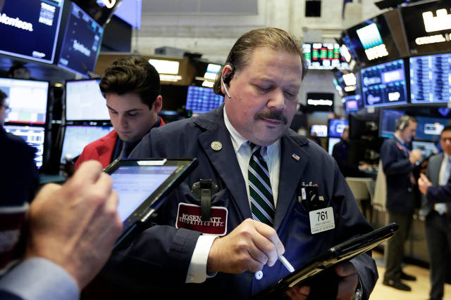 Trader John Santiago works on the floor of the New York Stock Exchange, Tuesday, April 10, 2018. Stocks are opening sharply higher on Wall Street as investors were encouraged to see conciliatory remarks from China's leader over trade. (AP Photo/Richard Drew)
