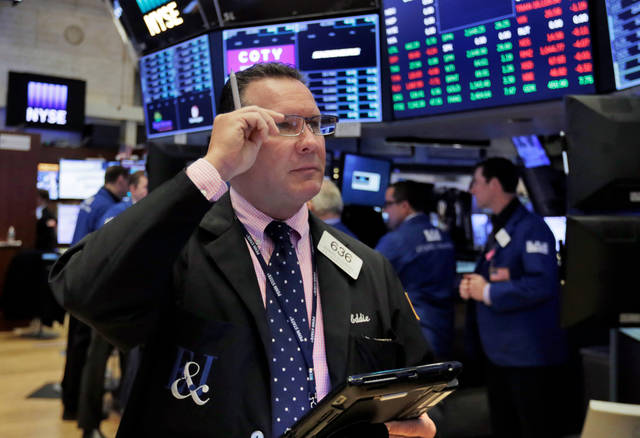 Trader Edward Curran works on the floor of the New York Stock Exchange, Tuesday, April 10, 2018. Stocks are opening sharply higher on Wall Street as investors were encouraged to see conciliatory remarks from China's leader over trade. (AP Photo/Richard Drew)