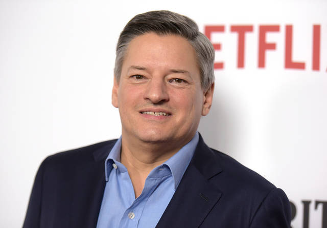 "In this Feb. 1, 2017 file photo, Netflix CCO Ted Sarandos arrives at the season one premiere of ""Santa Clarita Diet"" in Los Angeles. Sarandos says the streaming service is pulling its films from the Cannes Film Festival. Cannes earlier banned any films without theatrical distribution in France from its prestigious Palme d'Or competition. That essentially rules out Netflix movies."