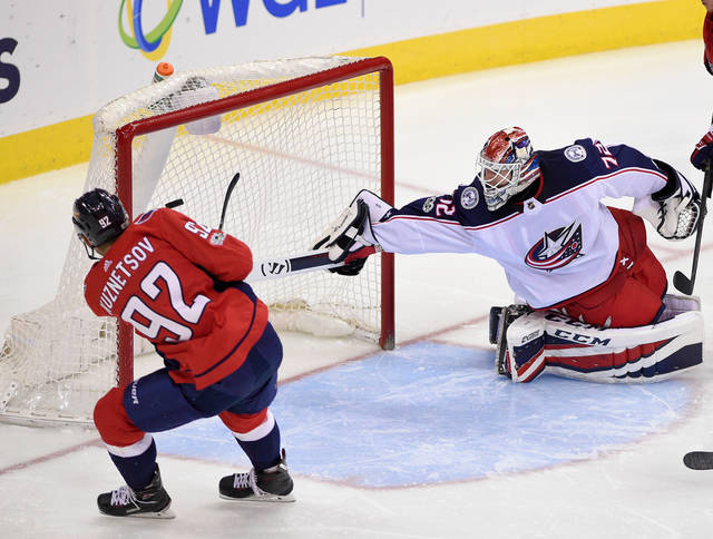 Washington Capitals center Evgeny Kuznetsov (92), of Russia, scores a goal against Columbus Blue Jackets goalie Sergei Bobrovsky (72), also of Russia, during the third period of an NHL hockey game, in Washington in December. Russian stars Alex Ovechkin, Evgeny Kuznetsov and Dmitry Orlov of the Capitals and Sergei Bobrovsky and Artemi Panarin of the Blue Jackets are expected to be difference-makers in what could be a tight series between Metropolitan Division-champion Washington and Columbus.